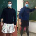 Lehrer unterrichten im Rock an spanischer Schule